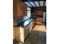 Kitchen wall units, base units and appliances including range master cooker.