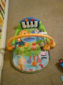 Fisher price -kick and play piano gym.