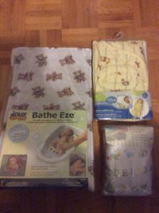 Winnie the Pooh swaddle blanket, fitted crib sheet and bath