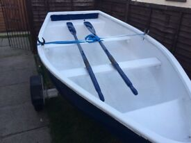 Fiberglass dinghy with trailer.