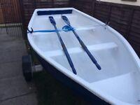 Fiberglass dinghy with trailer.