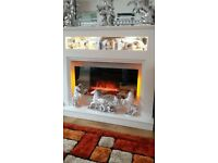 White fireplace with mirror front fire