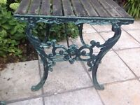 Garden table with wrought iron ends