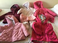 A bundle of girl's jackets from 6-9mth to 2-3 years -all in a perfect condition