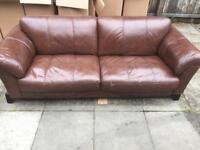 Brown leather sofa and coffee table