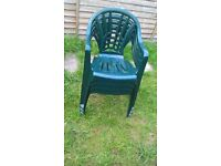 8 green plastic chairs
