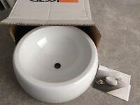 White, circular ceramic sink