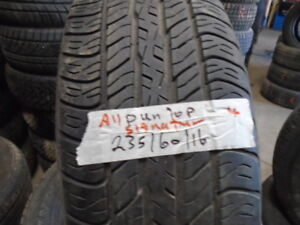 FOUR USED ALL SEASON TIRES  235-60-16 { DUNLOP } R,H AUTO