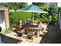 Patio chairs, parasol and table