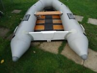 dingy with oars and foot pump
