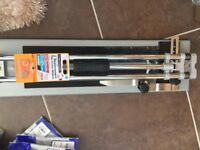 Tile cutter with two new spare blades