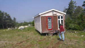Tiny URL house offgrit on wheels with property on the ocean