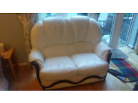 White two seater leather sofa. Good condition