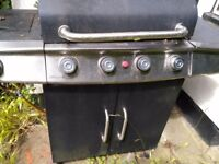Barbeque with hot plate and gas bottle