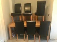 Wooden table with 6 brown faux leather chairs