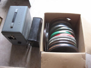 VERY OLD 16 mm MOVIE PROJECTOR + 12 EMPTY FEEL REELS