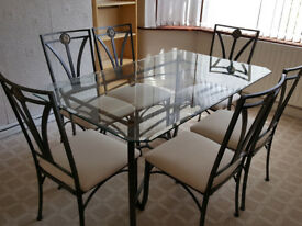 Metal and glass dinning table with 6 chairs in excellent condition