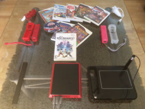 Nintendo Mini with 9 games plus Joy Sticks and You Draw Tablet