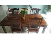 Solid dark wood table & 6 chairs