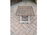 "20"" square.Sturdy wooden lattice table for outdoor use. Folds flat for storage. Good condition."