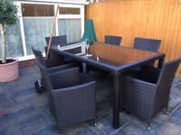 For sale a beautiful garden dining set in brown rattan.