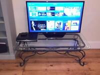 Glass coffee table or TV table. Good condition.