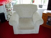 Two matching living room chairs with poo fay in light brown material