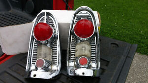 1956  CHEVROLET CHROME TAILLIGHTS, V8 RAD, DECK LID