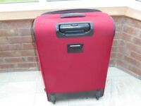 Tripp red suitcase