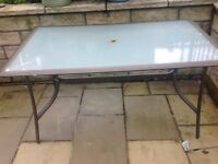 Large Glass top Patio Table.