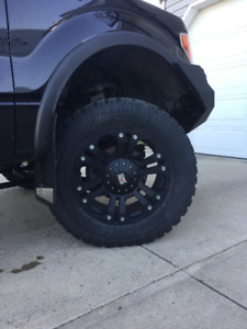 "20"" XD Monsters 6X135/6X139.7 with Pro comp tires"