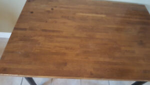 Wood table with 4 black chairs