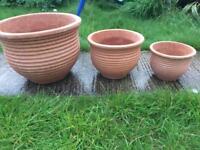Large set of terracotta garden plant pots