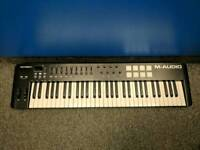 M-Audio Oxygen 61 key keyboard woth 8 Triger pads.