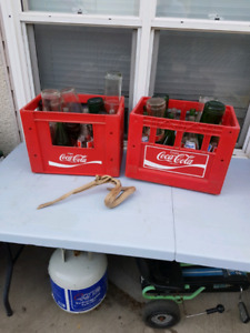 Coca-Cola bottles and case