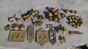 Solid cast brass cabinet knobs, light switch covers, and hooks