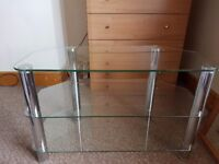 "Glass tv stand holds 32"" tv"