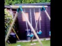 Wooden garden swing set by plum