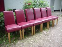 DINING CHAIRS - SET OF 6 - LEATHER TYPE UPHOLSTERY - SOME MATERIAL WEAR. SOLID CONSTRUCTION.