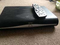 Sky + HD box with remote and HDMI.