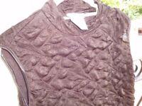 Kim & Co sleeveless top (QVC) light turtle neck, bubble material
