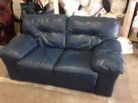 Navy blue leather sofa.