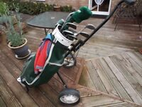 Golf Trolley with 8 club and some balls