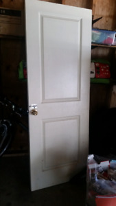 Interior door with bolt, knob and hinges attached
