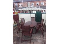 7 piece deep mahogany garden table and chairs