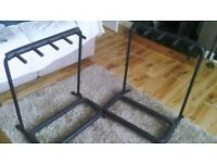2x folding padded guitar rack stands. Hold 4 guitars each