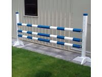 New horse jump for sale with 3 pressure treated 10ft poles + 2 uprights with cups.