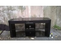 Tinted black glass Tv stand with built in speakers