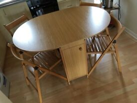 Table with folding sides+chairs