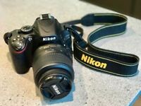 Nikon camera D5100 with extra lens